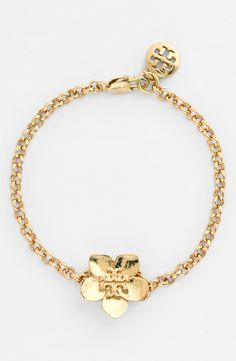 Such a dainty flower! Can't wait to wear this simple gold logo Tory Burch bracelet. Gold Jewelry, Jewelry Box, Jewelry Watches, Jewelry Accessories, Fashion Accessories, Jewelry Design, Fashion Jewelry, Simple Jewelry, Modern Jewelry