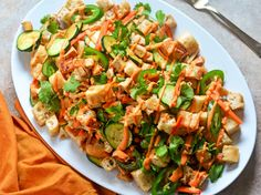 The classic flavors of Vietnamese banh mi sandwiches are reworked into the form of Italian panzanella, a salad designed to make stale bread delicious again. This version features pickled and fresh vegetables, lemongrass-marinated tofu, and two sauces that deliver spicy, sweet, and savory flavors.