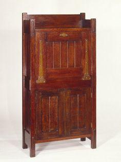 Gustav Stickley (1857-1942). Dropfront Desk, Closed Medium: Oak with copper hardware Dates: ca. 1903