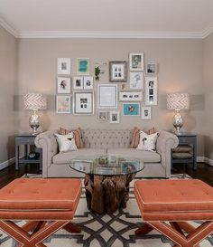 """Treat a gallery wall as one big piece of art.The central pieces should hang 57"""" on center; arrange the rest around them. As a general rule, keep art """"about 5 to 6 inches from the edge of furniture or windows,"""" Sacher recommends."""