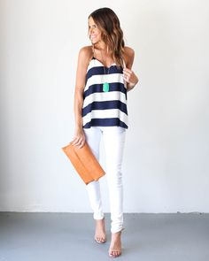 Simplicity is key and we are certain our Beckett Tank will be your new go-to! Simply chic, this navy and white striped tank has racerback straps and a sweet and flirty cut. Top is 100% Polyester. Mode
