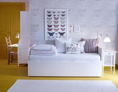 Daybeds, like BYGLAND, turn any space into a comfy guest bedroom.