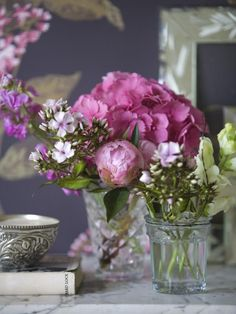 love using antiques for flowers...baby cups, crystal toothpick holders, sugar bowls etc...I like the gathering of several