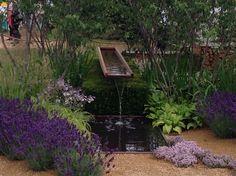 Water feature in Vestry Wealth's Vista garden Designed by Paul Martin. RHS Hampton Court Flower Show 2014.