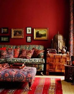 The ethnic furniture and mixed fabric patterns are great but the red walls are the real focal point in this cozy eclectic living room. Brown And Blue Living Room, Living Room Red, Living Room Decor, Cozy Eclectic Living Room, Eclectic Decor, Sala Oriental, Interior Bohemio, Style Salon, Bohemian Interior Design
