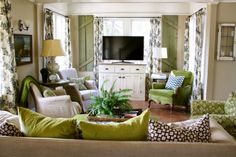 fab living room, green velvet chair, vintage items, lots of pillows