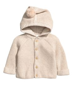 Check this out! BABY EXCLUSIVE/CONSCIOUS. Flat-knit cardigan in soft organic cotton with a hood decorated with a pompom. Buttons at front and long raglan sleeves with sewn cuffs. - Visit hm.com to see more.