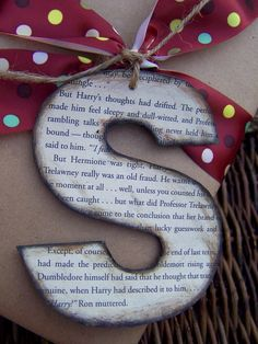 gift wrapping- instead of ripping a book, photo copy a page from a book. Use word/pages program with large font as template then glue onto cardboard to make sturdy.