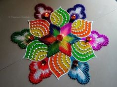 Draw simple Diwali rangoli designs and welcome goddess Lakshmi into your home. Use flowers, flower petals, and rangoli powder to create beautiful rangoli designs for Diwali images. Happy Diwali Rangoli, Diwali Special Rangoli Design, Easy Rangoli Designs Diwali, Rangoli Simple, Rangoli Designs Latest, Simple Rangoli Designs Images, Rangoli Designs Flower, Free Hand Rangoli Design, Small Rangoli Design