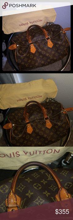 Louis Vuitton Speedy 40 Louis Vuitton Speedy 40. Pre owned In fair  condition other than a56331ea85e