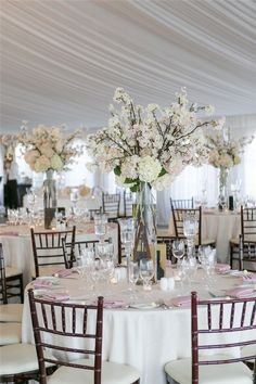 20 Glam Tall Floral Wedding Centerpieces   http://www.deerpearlflowers.com/20-glam-tall-floral-wedding-centerpieces/