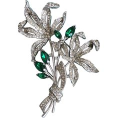 Outstanding, huge floral bouquet brooch designed for Trifari by Alfred Spaney, The design patent, 129553, was filed in 1941 and called Double