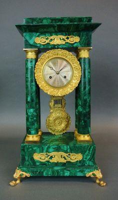 A 19TH CENTURY ORMOLU MOUNTED MALACHITE CLOCK : Lot 129