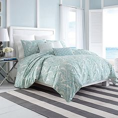 Create a serene sanctuary to retreat to every night with the Nautica Long Bay Comforter Set. The cool and inviting bedding is beautifully embellished with an airy watercolor paisley print in a soft mineral blue-green inspired by the sea.