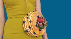 When heading out for a night on the town, you may find the toughest decision can be whether to go with the box of donuts or the stack of pancakes. This may sound like menu choices, but we're talking outfit accessories—and it's always best to go with your gut; your food gut. Rommydebommy's etsy store is filled with delicious looking cakes and cookies, even savory tacos, and more—all of which are actually handbags that look incredibly realistic.  Rommy started making these realistic foo...