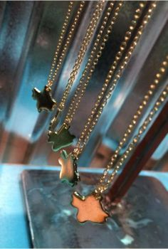 Delicate gold Texas-shaped necklaces from LizBeth Boutique at The Shoppes at Brownstone Village in Arlington, TX.
