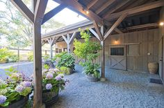 Absolutely love this inviting covered walkway. shed landscaping shed landscaping landscaping flower beds landscaping gravel of shed landscaping Dream Stables, Dream Barn, Horse Stables, Horse Farms, Equestrian Stables, Covered Walkway, Covered Porches, Horse Shelter, Horse Barn Plans