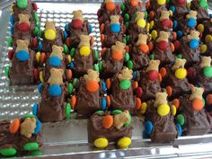 """Such a cute idea for a kids' party! Fun sized candy bars, m&ms, and teddy grahams! Use frosting or melted almond bark as """"glue."""" Mini-cars!"""