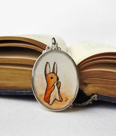 Velveteen Rabbit Necklace -- Hand Painted Watercolor Illustration Pendant USD 36.00 by SarahLambertCook   https://www.etsy.com/listing/68770717/velveteen-rabbit-necklace-hand-painted#