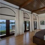 Anna Kournikova's Miami Beach Estate: Master Bedroom .Throughout the home, French doors highlight azure waters and lead to inviting outdoor entertaining areas.
