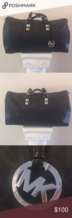 Micheal Kors Duffle Bag Micheal Kors Duffle Bag.  Black with MK Insignia print all over.  In excellent condition... only used once!!! 20 inches long and 9 inches wide.  It holds over two days worth of clothes and shoes💕🌸💕🌸 Perfect for that weekend get away🌸💕 Michael Kors Bags Travel Bags