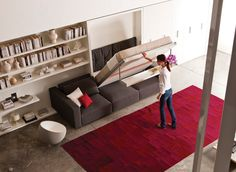 The sofa's top cushions can be removed, making it easy to pull the wall bed unit out over the sofa.