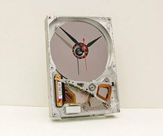 Recycled Computer Hard Drive Clock by pixelthis on Etsy Reuse, Upcycle, Computer Hard Drive, Recycled Home Decor, Desk Clock, Work Desk, Nerd Geek, Recycled Materials, Special Gifts