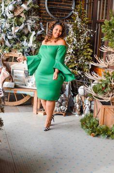 Off the shoulder green dress.