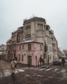 snow in paris - la maison rose in the snow, paris, france