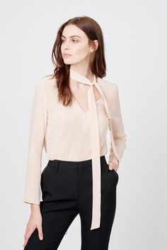 Introducing the season's style-savvy new silk—a beautiful bow blouse complete with an elegant neck tie. Crafted in New York City from premium 22mm silk crepe de chine, this sartorial piece is finished with a chic layered effect at the back. Style this piece for work with tailored trousers, or take it into the weekend with casual denim and slides.
