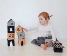 Ways to make old wooden blocks new again, like this painted house craft from Mer Mag