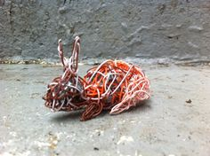 """This Bunny Rabbit - """"Recycled, Phone Wire, Miniature Animal Sculpture""""- is too cute! And since I know the artist, I know he was made with love and a dash of awesome."""