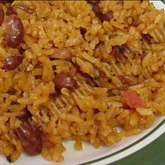 Puerto Rican Rice and Beans This is a traditional dish all Puerto Ricans could relate to, it's very good and flavorful and could be eaten with pork chops or fried chicken or any other meat. Puerto Rican Dishes, Puerto Rican Cuisine, Rice And Beans Recipe Puerto Rican, Authentic Puerto Rican Rice Recipe, Rice And Pink Beans Recipe, Yellow Rice Recipes, Mexican Food Recipes, Dinner Recipes, Recetas Puertorriqueñas