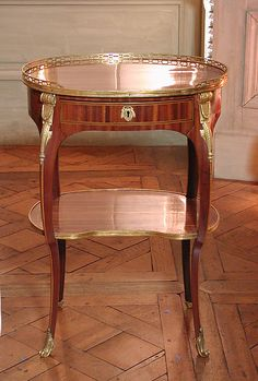 Small oval writing table (one of a pair) Maker: Roger Vandercruse, called Lacroix (French, 1727–1799) Date: ca. 1775 Culture: French, Paris Medium: Oak veneered with satiné wood, tulipwood; leather; gilt bronze