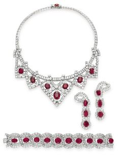 Elizabeth Taylor -- A suite of ruby and diamond jewelry by Cartier given to ET by Mike Todd August 1957
