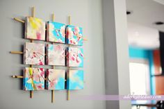 Sectioned Canvas Wall Art  The bamboo sticks and the cool turquoise of the photograph give this DIY a very organic and refreshing look. The fragmented look appears a lot more artsy than the usual giant framed photograph hung on the wall. [from: adorkable duo]
