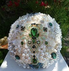 "Ivory & Emerald 10"" Bridal Brooch Bouquet Elegant Ivory Flowered Bridal Bouquet with accents of Emerald Green Brooches and Gems Ivory Satin handle With Emerald Germ accent....WOW"