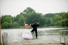 hilarious portrait of bride and groom jumping on dock - photo by New York based wedding photographers Maloman Photographers
