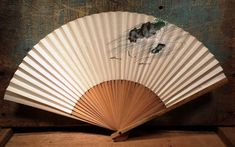 A very pretty vintage souvenir fan. The wood is natural with an ornate yet simple design of fish swimming. This fan is in very good condition with just a little stain on the wood from age. Fish Swimming, Vintage Ceramic, Asian Art, Hand Fan, Simple Designs, Vintage Items, Fans, Etsy, Products