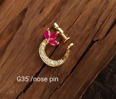 No photo description available. Nose Ring Jewelry, Gold Nose Rings, Bridal Jewellery Inspiration, Jewelry Trends, Gold Earrings Designs, Gold Jewellery Design, Royal Jewelry, Indian Jewelry, Nose Ring Designs
