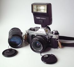 Vintage Canon AE-1 Program 35mm SLR Camera w/28mm lens, 55mm zoom, flash and manuals