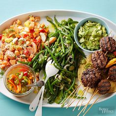Eating outdoors is our summer happy place. A big party platter makes for moveable feasting -- wherever you are! Summer must-haves like potato salad, grilled sliders, and guacamole are served up family-style. Invite List: 8 Guest Type: Anyone/