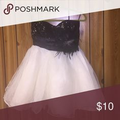 Masquerade party dress Black sequins and tull bottom. Has a feather design on the left side speeckless Dresses Strapless