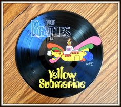 The Beatles Yellow Submarine, painted on a vinyl record in acrylic paint. The Beatles Yellow Submarine, painted on a vinyl record in acrylic paint. Record Wall Art, Cd Wall Art, Cd Art, Vinyl Record Crafts, Vinyl Art, Vinyl Records, Beatles, Cute Canvas Paintings, Spray Paint Art