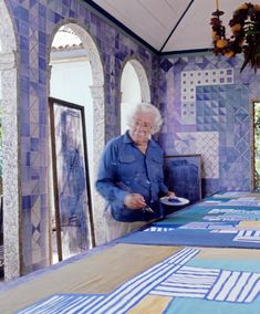 Roberto Burle Marx at home, photographed in the 1980s; he designed the tile wall and chandelier.