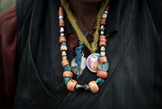 A nomad's necklaces. Much of Upper Mustang is desolate, inhabited by about people. Credit: Gilles Sabrie for The New York Times The Forbidden Kingdom, Mustang Nepal, The Vanishing, Walking, Necklaces, York, Times, People, Photos
