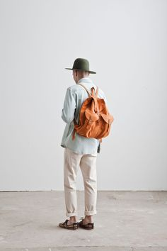 green hat, orangey backpack, denim shirt, white jeans. I got all these things