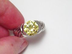 This is a beautiful  fine Sterling silver canary yellow cubic zirconia diamond alternative gemstone ring. The sparkle is amazing, even in low light it seems to glitter and glow! Photos do not do it justice. This is a cant beat price for an engagement ring or dinner ring or for the club!  #beautiful #jewelry #estate #vintage #diamond #zircon #yellow #sale #womens #ladies #engagement #wedding #designer #cocktail #gift #clothing #makeup #accessories #gemstone #rings
