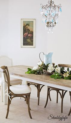 Beach House Tablescape Ideas from Shabbyfufu Blog.  I love my favorite huge blue pitcher surrounded by magnolias from the garden.