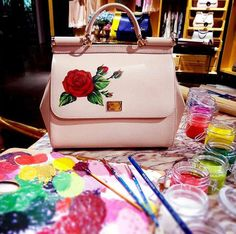 Dolce & Gabbana: A red rose is for love… Love for a personalised, handpainted Bag! Dolce & Gabbana, Dolce And Gabbana Handbags, Bags Online Shopping, Discount Shopping, Online Bags, Painted Bags, Hand Painted, Drawing Bag, Retail Design